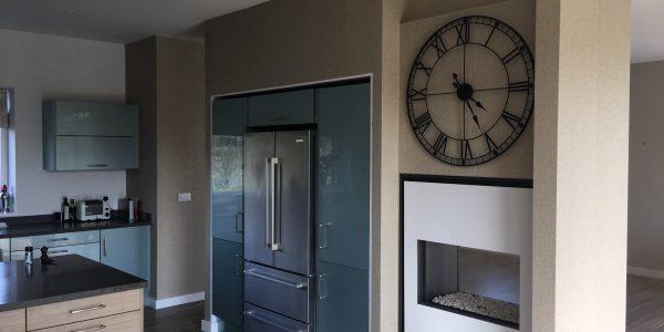 wallpaper around cabinets