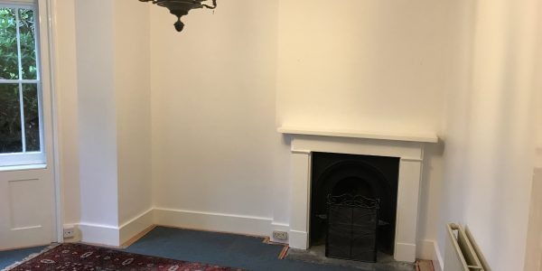 fire place with white walls