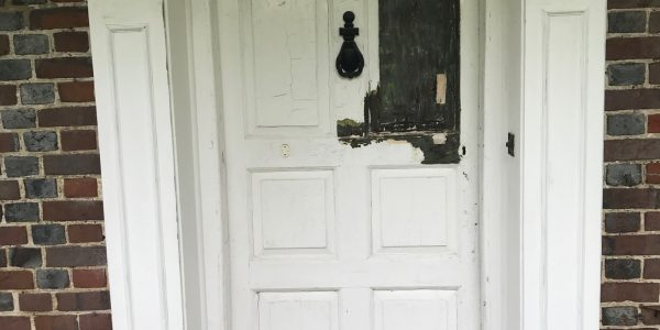 front door with paint stripped