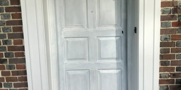 front door with large white frame