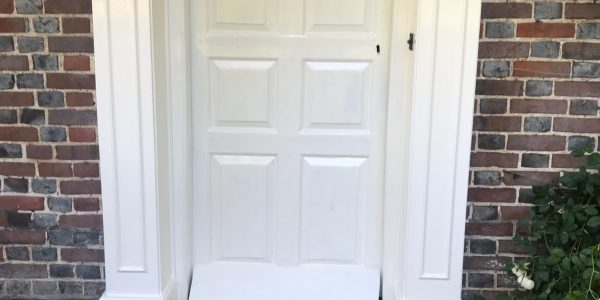 White front door with white frame