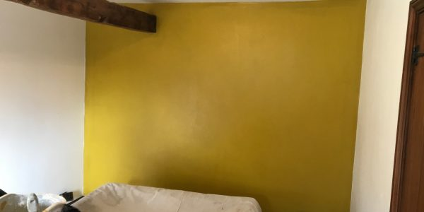 wooden beam with yellow wall