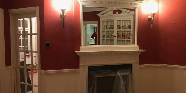 fireplace with mirror above