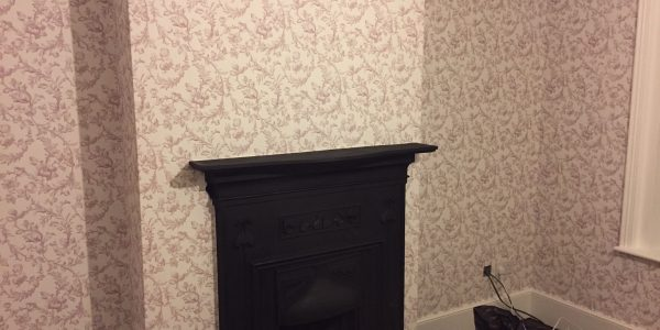 wallpaper around the fire place