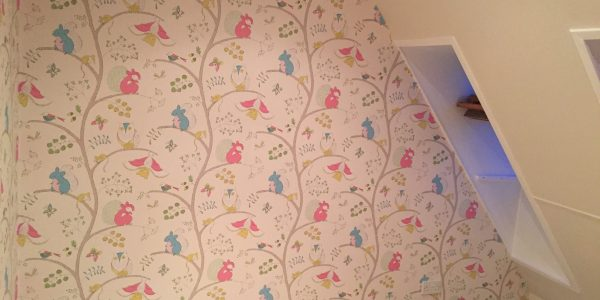 wallpapering in the attic
