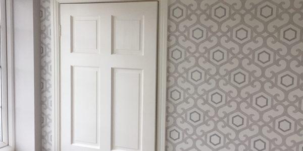 wallpaper around door frame