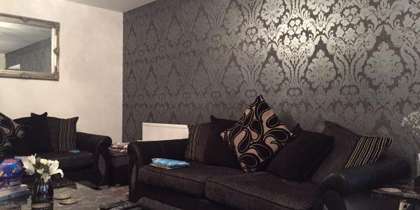 wallpaper on back living room wall